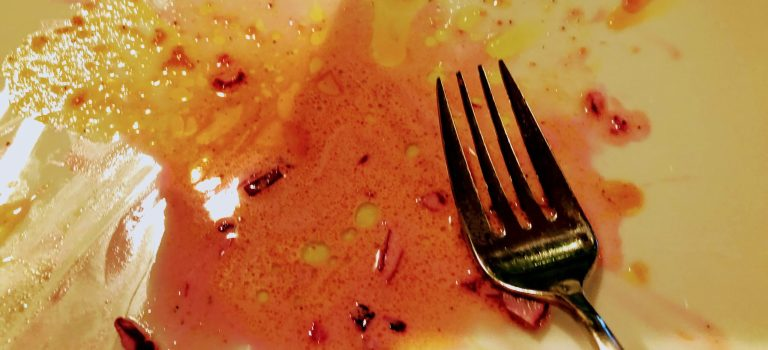 Fork on an empty plate