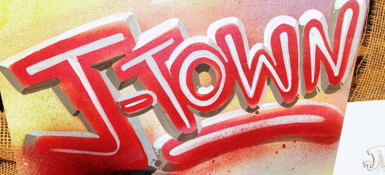 Spray painted sign: J-TOWN