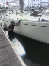 Benjamin cleaning the hull