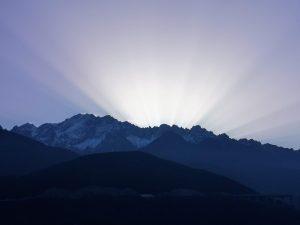 Beautiful sun over the mountain on road trip to Shangri-la