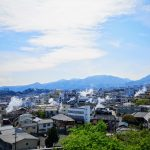 VIew of Beppu from the top with steams over the city