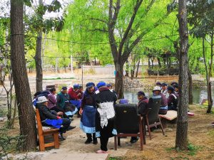 Elderly ladies from Naxi ethnic minority gathering near LIjiang