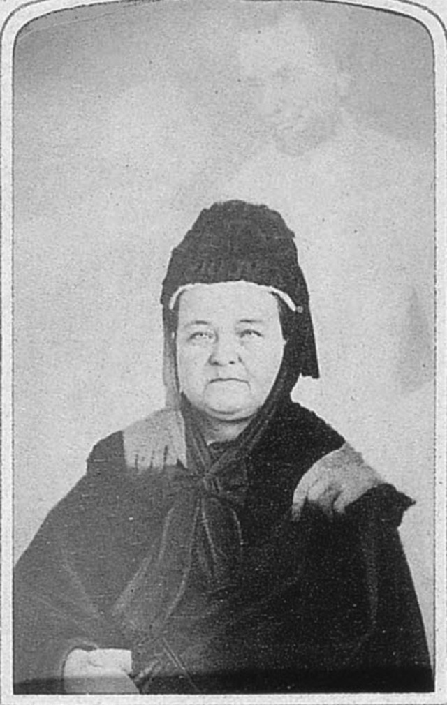 "Mary Todd Lincoln with the ""ghost"" of her husband."
