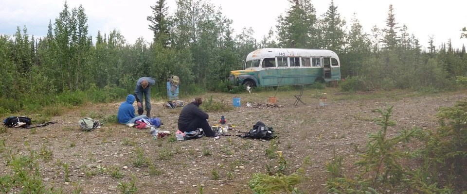 Hikers take a break at Bus 142 on the Stampede Trail.