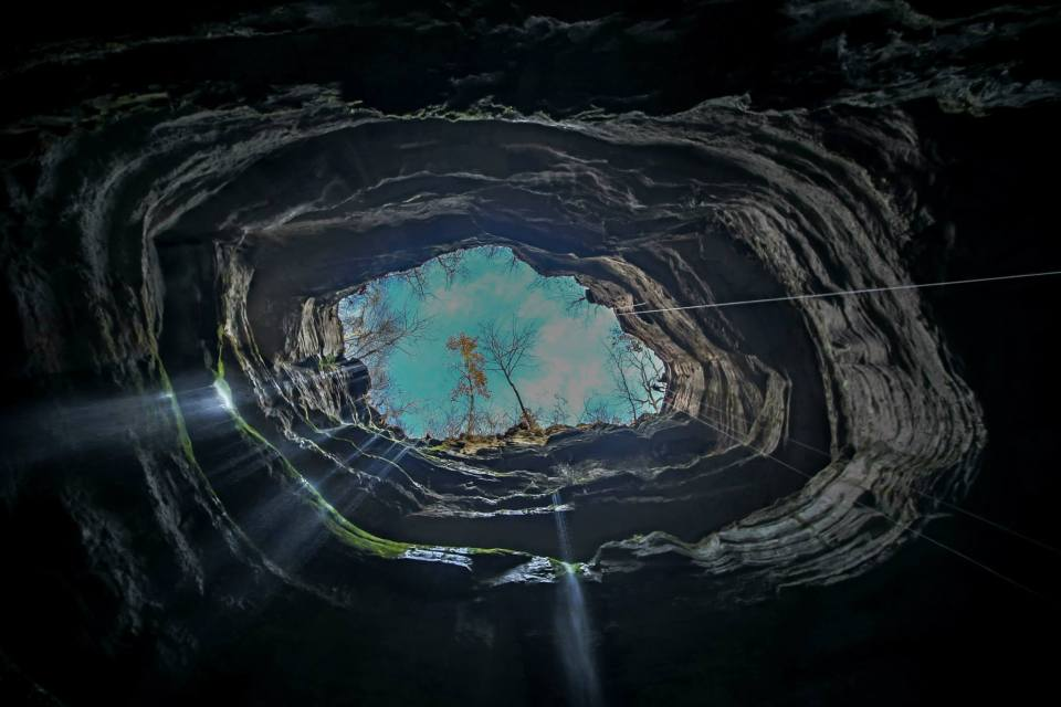 Looking up from the bottom of Neversink Pit, cave in Alabama