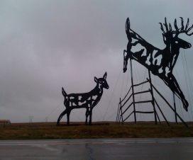 Deer crossing sculpture