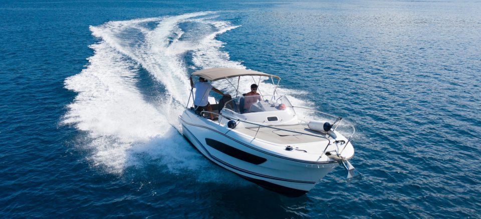 High speed motor boat on open sea. Travel, transportation and leasure activities