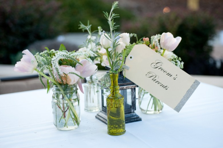 mason jar and glass bottles with single stems