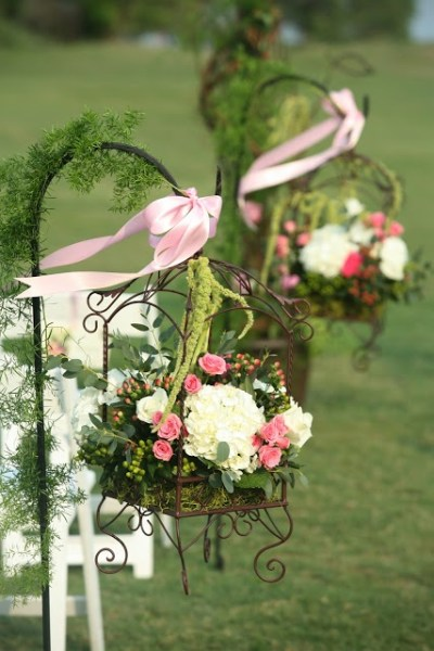flowers in birdcages on hooks