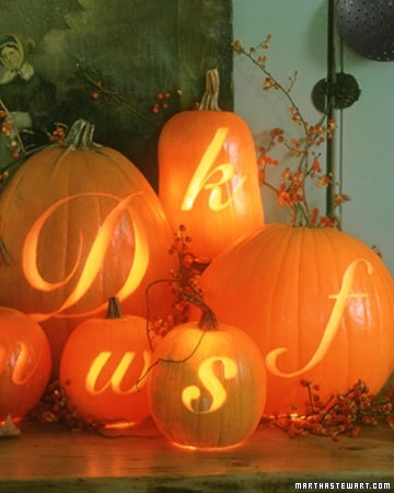 carved pumpkins with couples initials