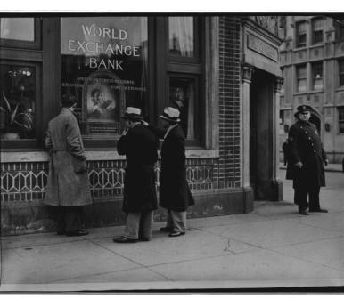stand guard at the entrance to the World Exchange Bank at 174 Second Avenue, New York City.  It had been closed down today due to a run on it. March 20, 1931. 306-NT-443-J-1