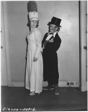 """WPA Federal Theatre Circus. """"La-La"""" famous clown lends a hand to the star aerialist of the show, Avon Gardner. 69-TC-NYC-19-529-6."""