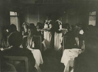 "Original Caption: ""Party ""E"" - June 7, 1931. Pilgrims in diner enroute Cherbourg to Paris."" Local ID: 92-GS-2-186."