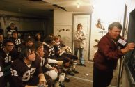 Pregame discussion by the coach for Cathedral Senior High School football players prior to a game at Johnson Park in New Ulm Minnesota., October 1974. Local ID: 412-DA-15754