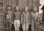 Original Caption: 40th Division, Camp Kearny, San Diego, California. Various types of gas masks used by the Allies and the Germans. From left to right they are: American, British, French and German. April 19, 1918. Local Identifier: 111-SC-9194
