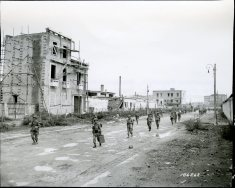"111-SC-186263 ""Parachute regiment, Headquarters company, entering the city of Naples, Italy. 505th Parachute Regt., Hdqrts. Co."" October 2, 1943"