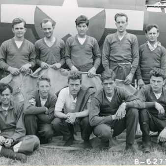 """342-FH-3A """"Lt. Lockhart and crew of the 401st Bomb Squadron, 91st Bomb Group, 8th Air Force beside a B-17 Flying Fortress. England, 18 August 1943."""""""
