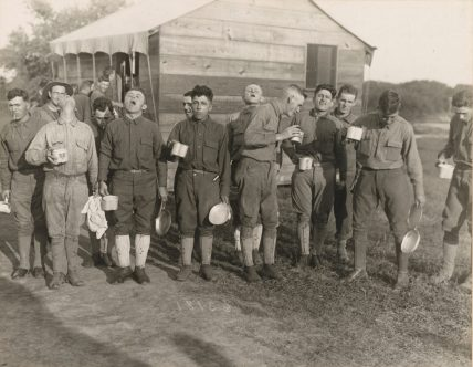 Protection against influenza. Men gargling with salt and water after a day working in the War Garden at Camp Dix. Local Identifier: 165-WW-269B-6