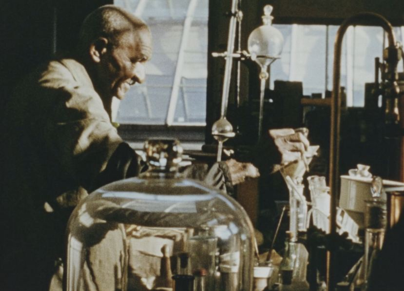 George Washington Carver works in his lab.