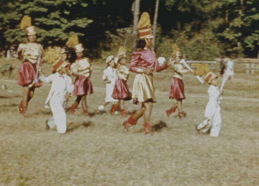 The Tuskegee Institute drill team performs at a football game.
