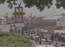Marchers gather at the Lorraine Motel, site of the King assassination. (Still from 306.6004, reel 5)