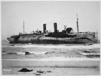 Transport Northern Pacific on Fire Island sand bar as she lay 200 yards off the Fire Island beach in approximately 11 feet of sand. Local Identifier: 111-SC-34274.