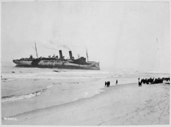 Transport Northern Pacific on Fire Island sand bar as she lay 200 yards off the Fire Island beach in approximately 11 feet of sand. Local Identifier: 111-SC-34276.