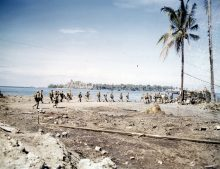 """Photo ID: 127-N-68168. Original caption: """"Marines leaving Bougainville. The first large element to depart."""" Photographer: Sgt. V.M. Hanks. Date: December 25th, 1943."""