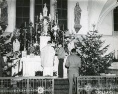 """Photo ID: 342-FH-3A-17906-73015AC. Original caption: """"Midnight High Mass on Christmas Eve in the chapel at the 410th Bomb Group base in France."""" Date: December 24th, 1944"""