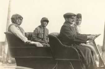 A group of travelers speeds towards the toll-gate in their new automobile, and the driver becomes irate that he must stop so often on the road at such junctures. Photo number 30-N-40-718-B.