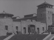 The gates of Mauthausen after liberation. The Nazi Reichsadler (imperial eagle) was removed by this point.