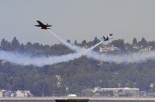US Navy (USN) Blue Angels lead and opposing solo pilots, in F/A-18A Hornets, perform a crossing maneuver over Lake Washington during Seattle SEAFAIR events in Seattle, Washington (WA). SEAFAIR is Seattle's month-long traditional summer festival, with parades, amateur athletics, air shows and boat racing. [2005] Local Identifier: 330-CFD-DN-SD-06-05018 (https://catalog.archives.gov/id/6668676)