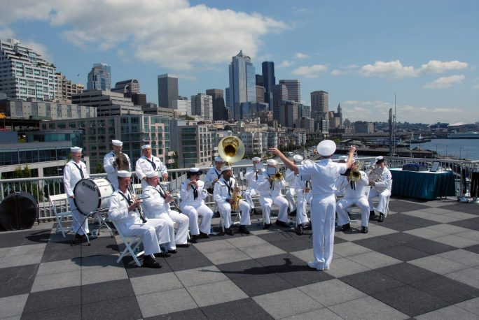 (Aug. 2, 2006) The US Navy (USN) Northwest Band plays military music during the Seattle Seafair Parade of Ships in Seattle Washington (WA). The parade marks the beginning of Seafair's Fleet Week by our Sailors, Marines and Coast Guardsmen. U.S. Navy photo by Mass Communication SPECIALIST Third Class Douglas G. Morrison (RELEASED). Local Identifier: 330-CFD-DN-SD-07-09532 (https://catalog.archives.gov/id/6699020)