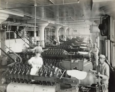 Wrigley Factory. Extracting all foreign matter from chicle by forcing it through heavy fine-mesh canvas cloths. Local Identifier: 165-WW-192D-13.