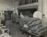 Wrigley Factory. Weighing bags of granulated sugar in receiving department. Local Identifier: 165-WW-192D-5.