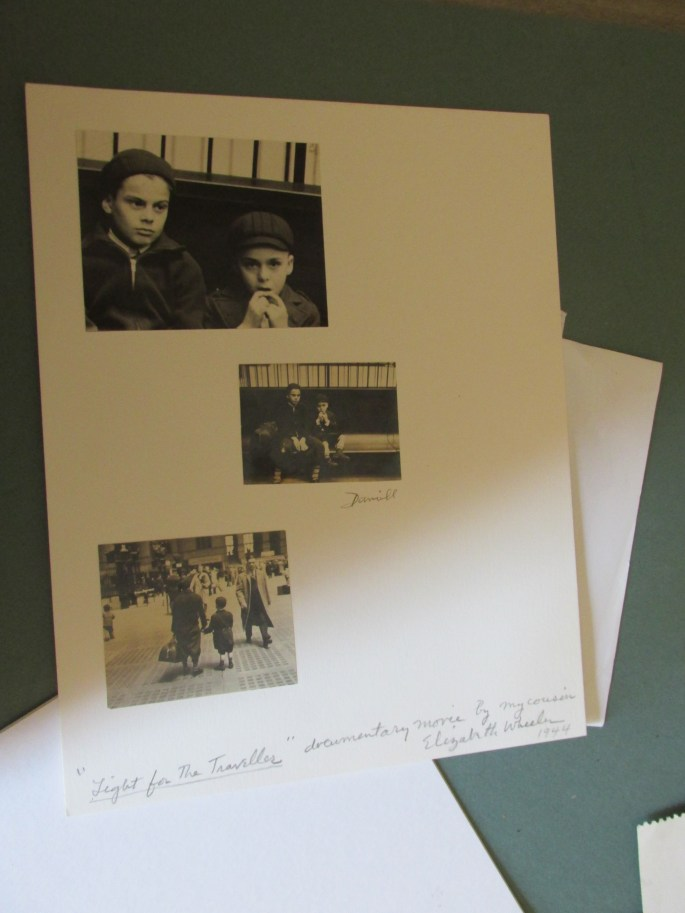 """Author snapshot of an album sheet showing stills from Elizabeth Wheeler's """"Light for the Traveller"""", from the papers of George Daniell. The original album sheet is held by Gina & Dwayne DeJoy and the George Daniell Museum."""