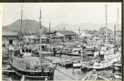 """Local Photo ID: 243-HP-I-51 (NAID 175739145). Original Caption: """"This relatively small harbor was developed as port for the city of Hiroshima, and has been one of the principal embarkation depots for the Japanese Army since the Sino-Japanese War. Only 20 percent of the harbor facilities were available for civilian activities. One of the important functions of Ujina Harbor was to act as the base for trade and communications with the Matsuyama area on the island of Shikoku. Passenger steamers plying between Hiroshima, Osaka, Etajima, and various ports on Shikoku and Kyushu stopped here. Fish is a Japanese dietary staple, and a fishing fleet based in Ujina Harbor operated on the Inland Sea. The harbor was never open to ships of foreign countries, but reports show that foreign trade amounting to about 500,000,000 yen was handled at the port by Jap ships in 1935."""""""