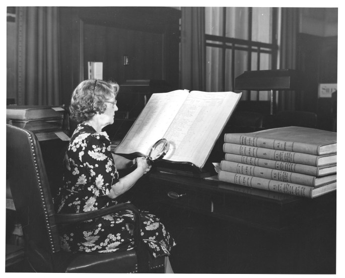 Photograph of Researcher in the Central Search Room of the National Archives Building