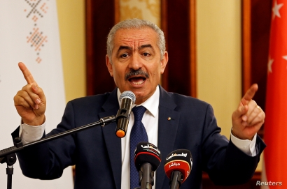 FILE - Palestinian Prime Minister Mohammad Shtayyeh gestures as he speaks during a workshop on cooperation between Palestinians and East Asian countries, in Jericho in the Israeli-occupied West Bank July 3, 2019.