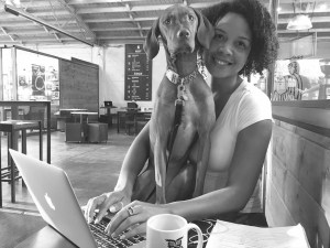 Photo Courtesy of Jillian Tullis, PhD Tullis, PhD, with her pup Rouxbee at a local coffee shop.