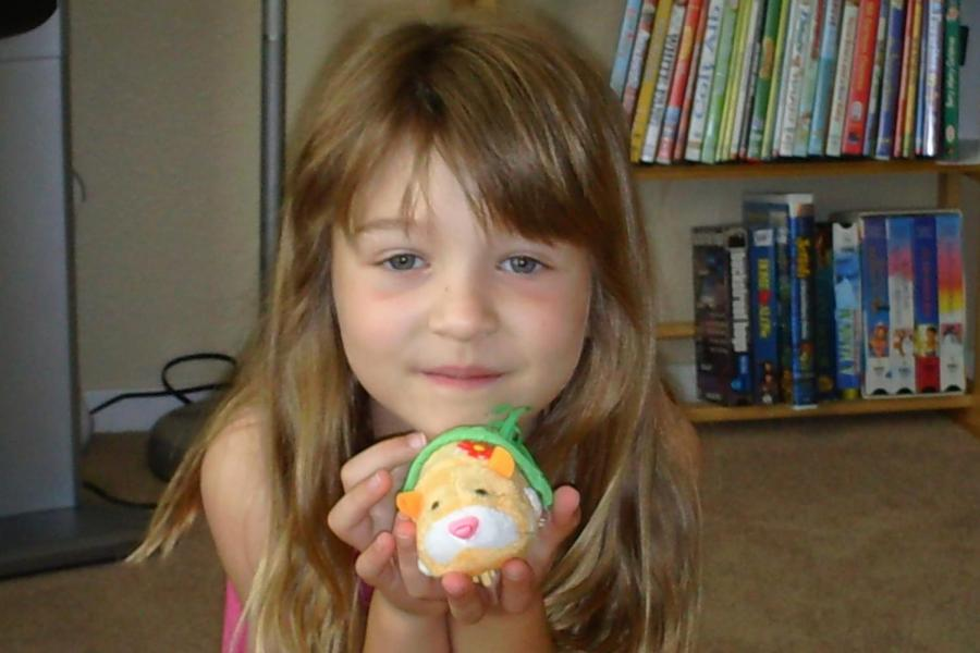 Taken in 2010, a five-year-old Alexandra shows off her Zuzu pet and unbrushed bangs, the same year Swift debuted bangs of her own.