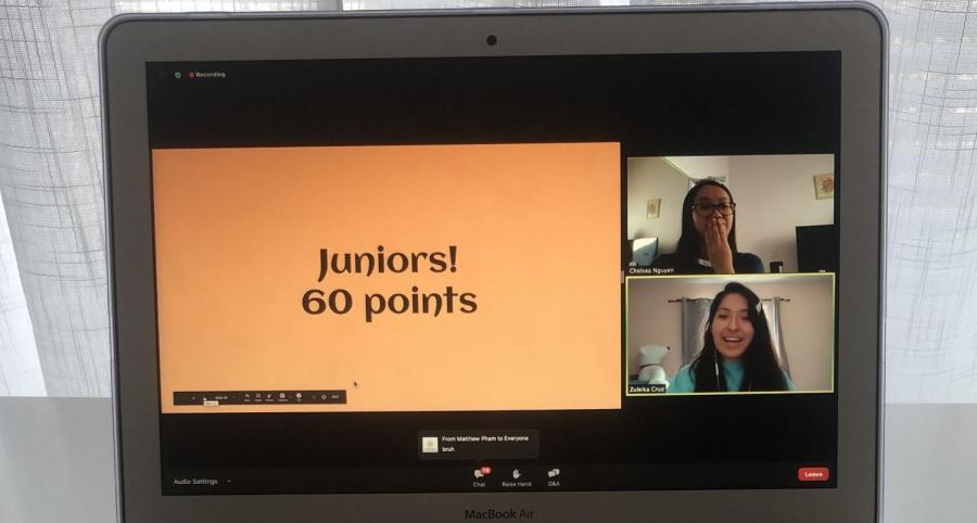 Chelsea Nguyen covers her mouth in surprise as Zuleika Cruz announces that the juniors received last place with 60 points. In the chat, seventh grader Matthew Pham writes bruh.