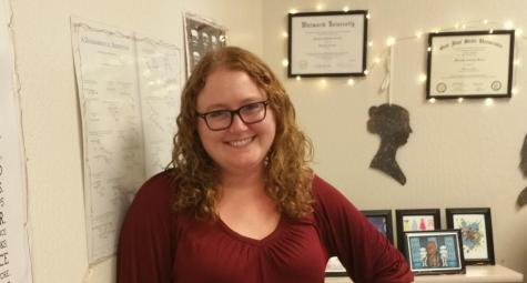 English teacher Meredith March poses for a photo in her classroom in Dartmouth, where she has been working during distance learning.