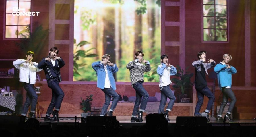 """ENHYPEN commences their online fanmeet with their performance of """"10 Months."""" From left to right: Sunghoon, Heeseung, Ni-ki, Jake, Sunoo, Jungwon, and Jay."""