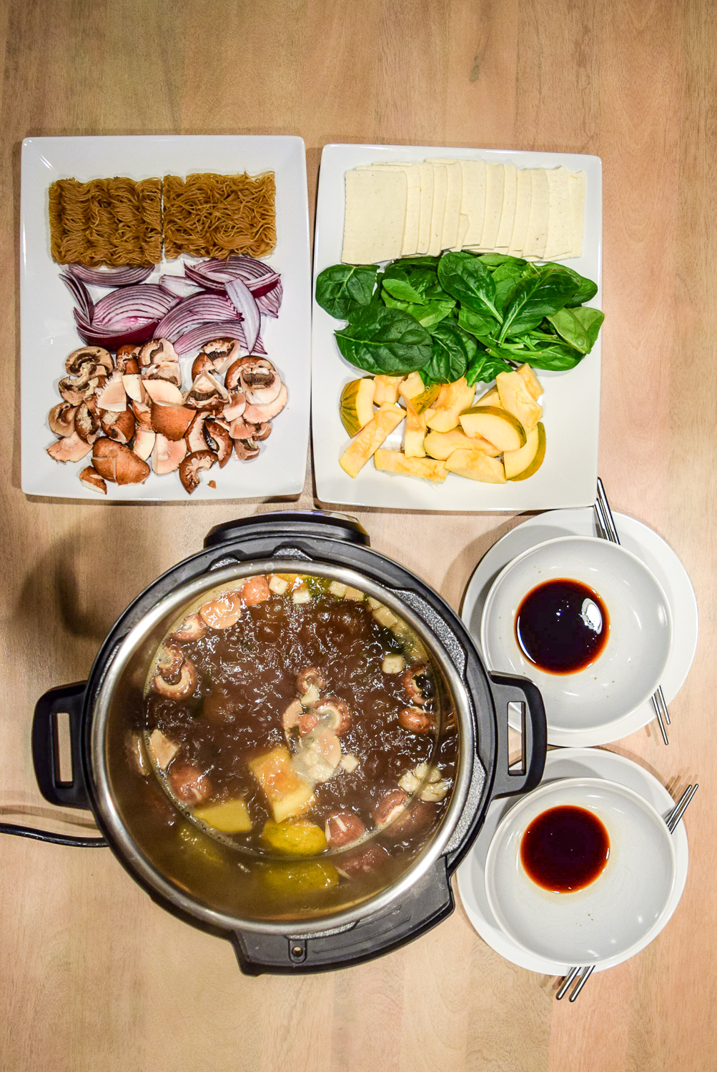 Instant Pot Hot Pot for two boiling with dipping sauce from top
