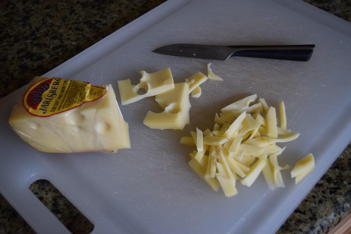 Jarlsberg cheese cut up