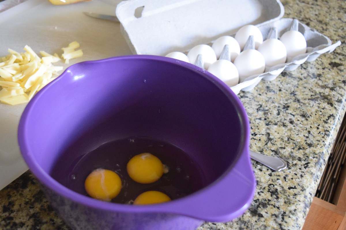 Eggs cracked in mixing bowl