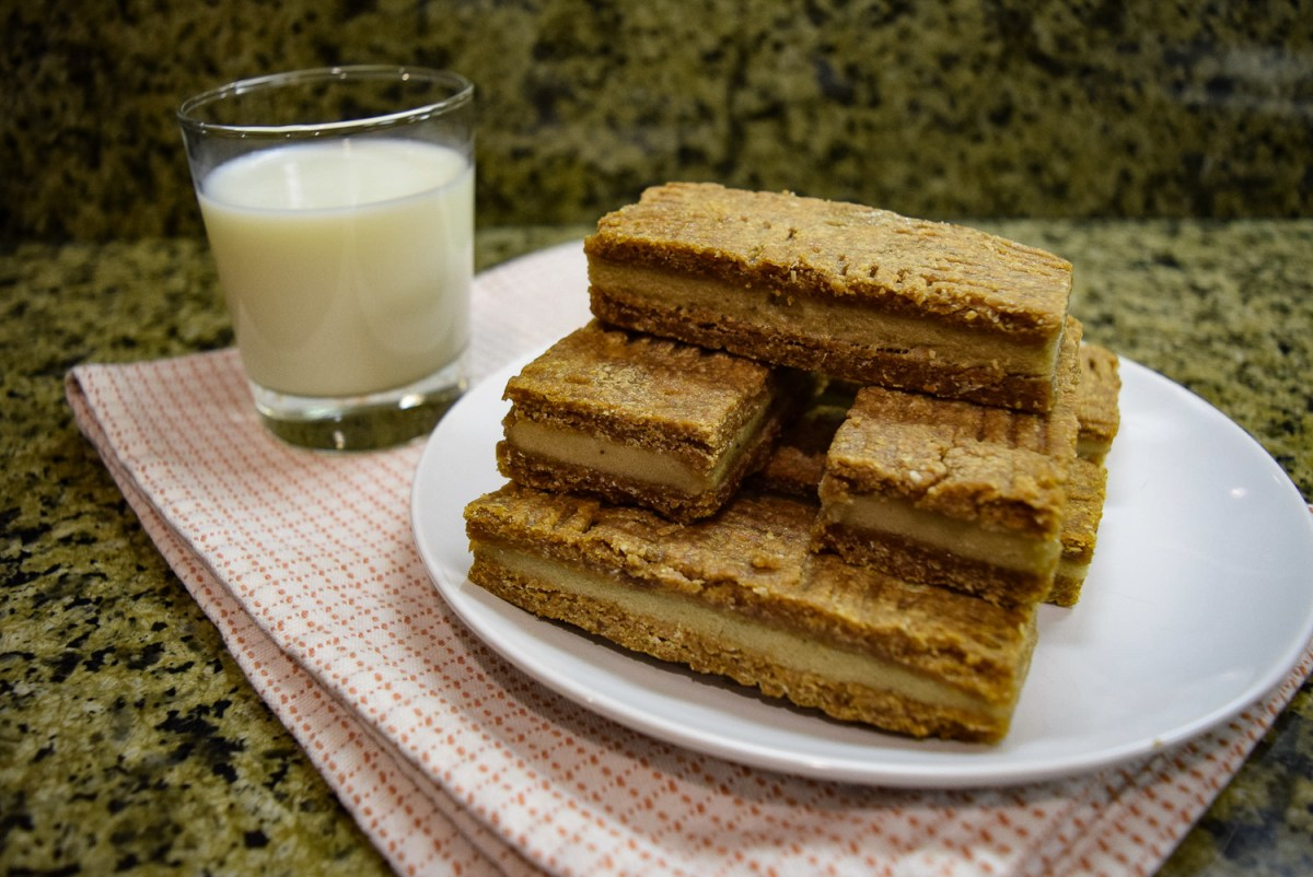Peanut Butter + Banana Ice Cream Sandwiches with glass of milk from the side