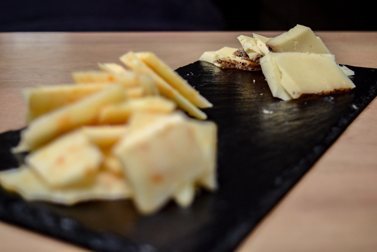 Close up on Trader Joe's Black Pepper Toscano on Gluten-Free Peppery Slate Cheeseboard