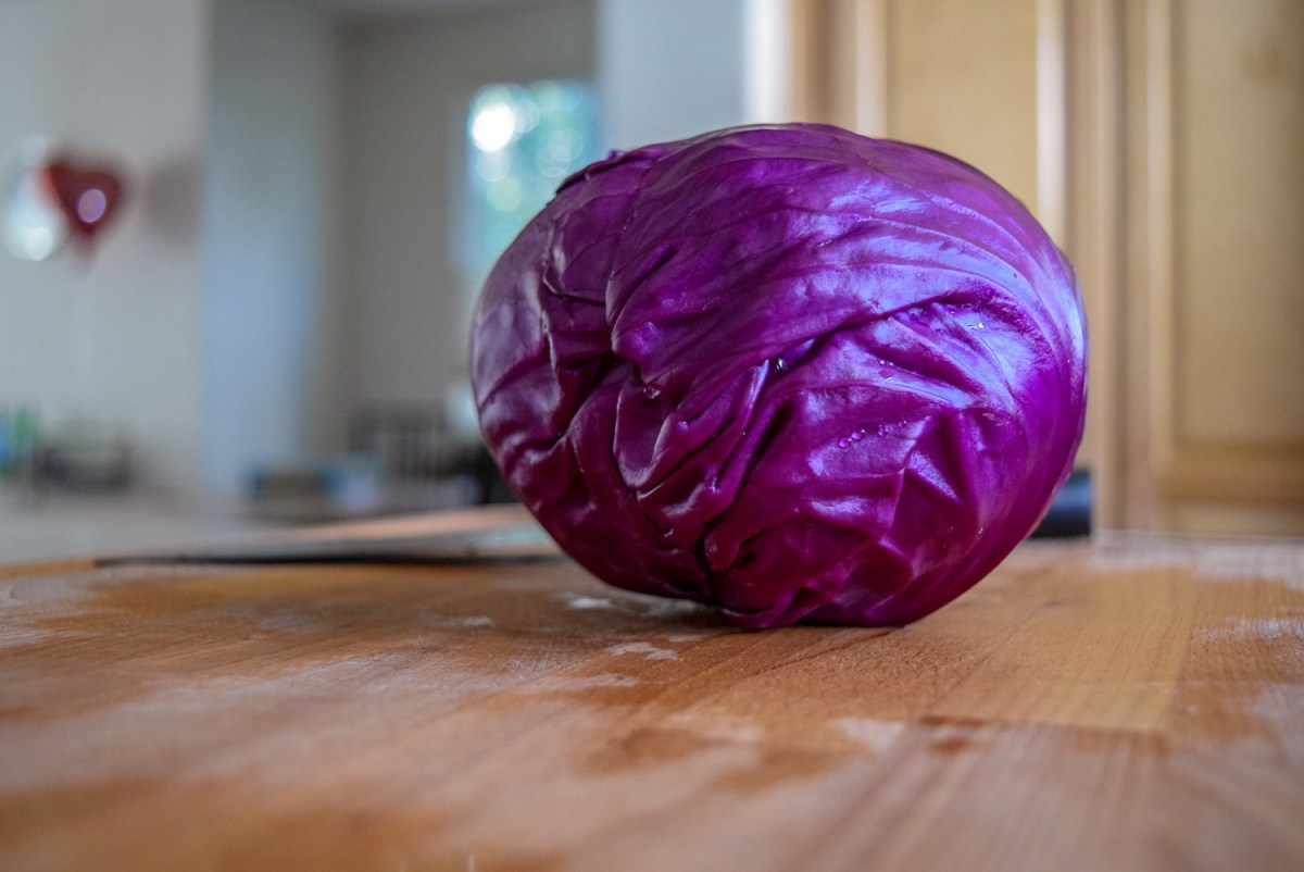 Whole red cabbage for Sunshine Spicy Mustard Tahini Cruciferous Slaw
